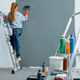 Female house painter paints walls indoor - PhotoDune Item for Sale