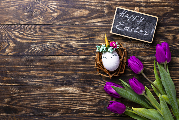 Easter background with tulip and unicorn eggs - Stock Photo - Images