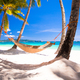 View of cozy straw hammock on the tropical white beach - PhotoDune Item for Sale