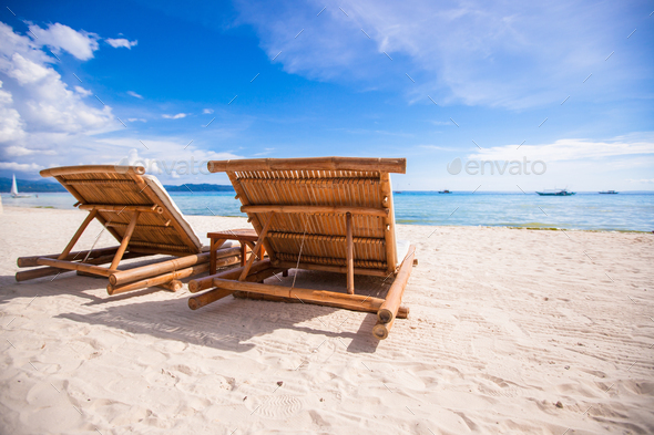 Beach wooden chairs for vacations and summer getaways in Boracay - Stock Photo - Images