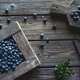 Freshly picked blueberries are in a wooden box. Healthy food, health - PhotoDune Item for Sale