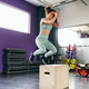 Fitness woman jumping onto a box as part of exercise routine - PhotoDune Item for Sale