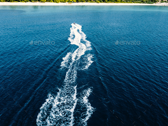 Aerial view of jet skier in blue sea. Jet ski in turquoise clear water racing - Stock Photo - Images
