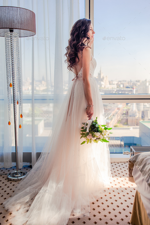 Wedding day. Portrait of beautiful bride with bouquet - Stock Photo - Images