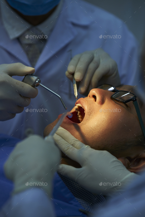 Dentists Doing Dental Surgery - Stock Photo - Images