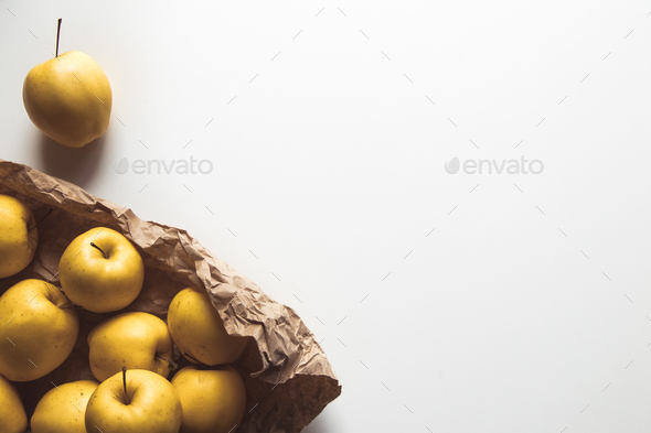 apples in shopping paper bag on white background - Stock Photo - Images