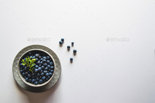 Blueberries in bowl isolated on white background. Healthy food, health - Stock Photo - Images