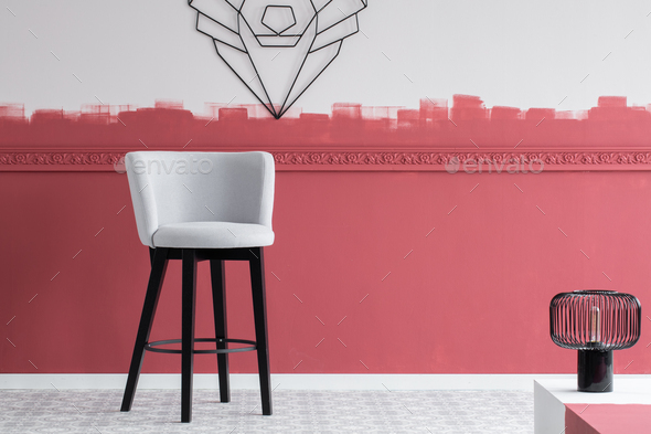 Stylish modern installation on the wall of trendy interior with elegant grey chair - Stock Photo - Images