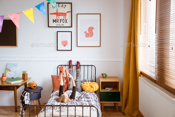 Cute vintage style posters on white wall of trendy bedroom for child - Stock Photo - Images