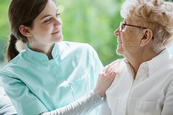 Happy senior woman and helpful caregiver, nursing home concept photos - Stock Photo - Images