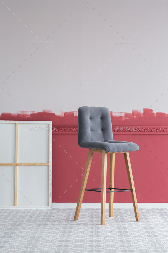 Tall grey stool in empty interior with painting and ombre wall - Stock Photo - Images