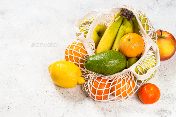 Mesh bag with fruits, zero waste shopping - Stock Photo - Images
