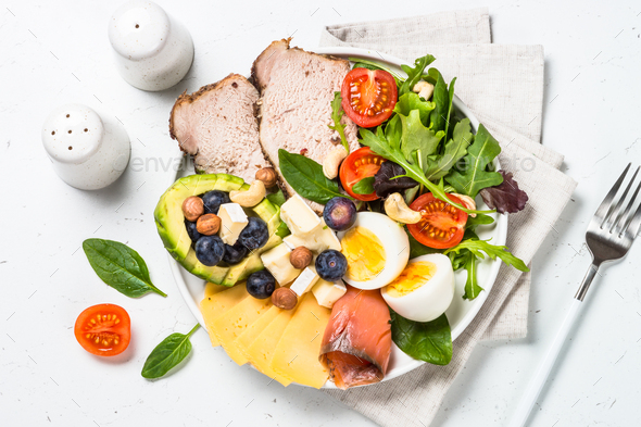 Keto diet plate on white table - Stock Photo - Images