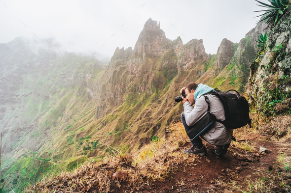 Santo Antao Island, Cape Verde. Hiking outdoor activity. Male traveler photographing mountain peaks - Stock Photo - Images