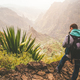 Santo Antao Island, Cape Verde. Hiking outdoor activity. Male traveler with backpack photographing - PhotoDune Item for Sale