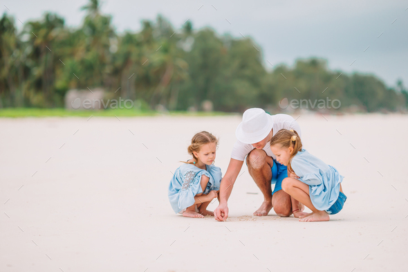 Father and kids on the beach - Stock Photo - Images