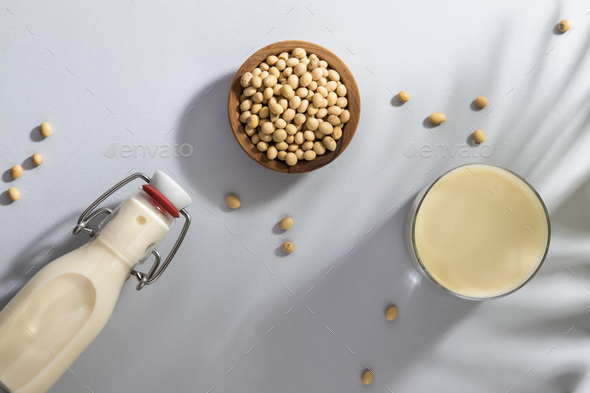 Soy milk and soy bean on gray table - Stock Photo - Images