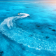 Aerial view of floating water scooter in blue water at sunset - PhotoDune Item for Sale