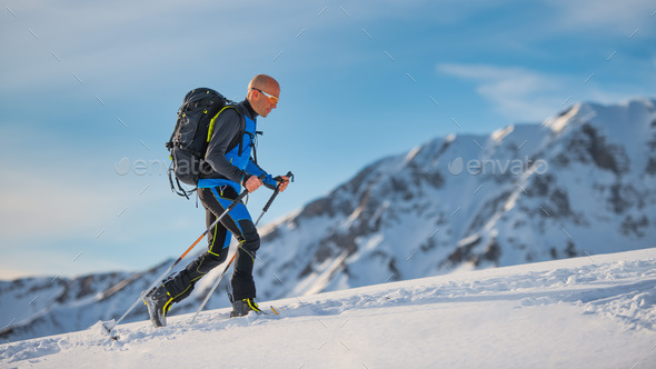 Uphill with skis and seal skins - Stock Photo - Images