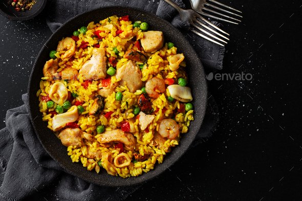 Spanish paella on plate on table - Stock Photo - Images