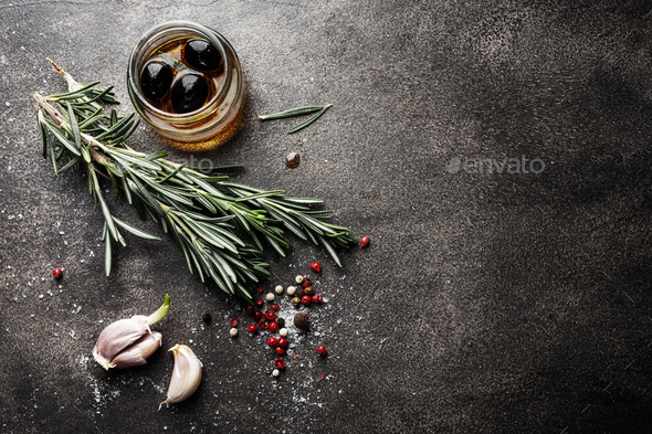 Spices and herbs on dark background - Stock Photo - Images
