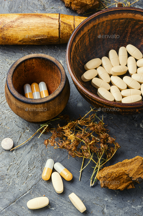 Medical pills with healing herbs - Stock Photo - Images