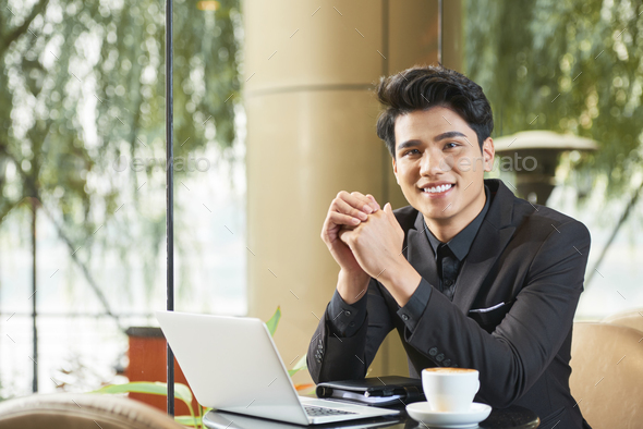Cheerful Asian Businessman In Cafe - Stock Photo - Images