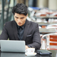 Businessman Using Netbook In Cafe - PhotoDune Item for Sale