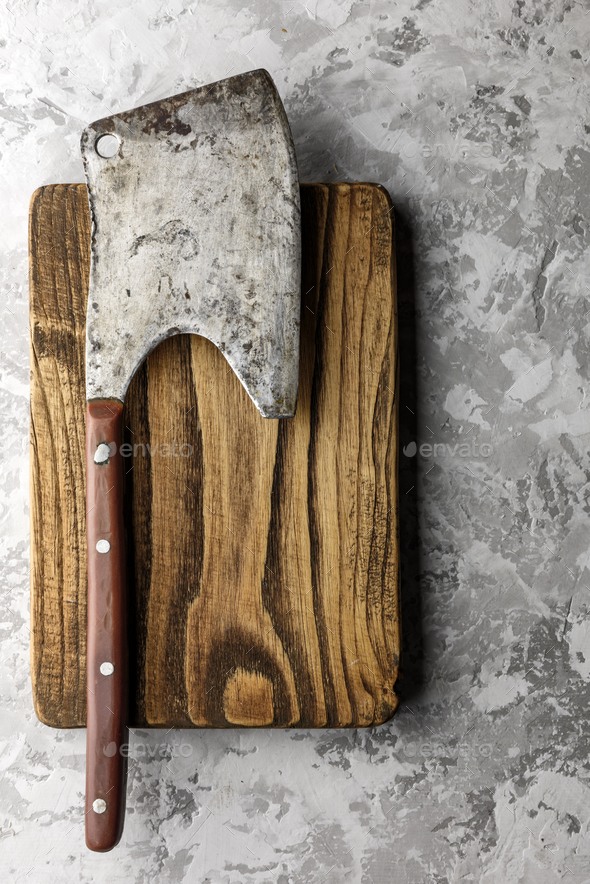 Old rustic axe for meat on a wooden board - Stock Photo - Images