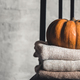 A stack of warm knitted sweaters on a white background. Autumn concept - PhotoDune Item for Sale
