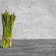 Fresh bunch of asparagus with smooth daylight on grey stone background/top view - PhotoDune Item for Sale