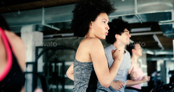 Group of fit healthy friends people cardio workout in gym - Stock Photo - Images