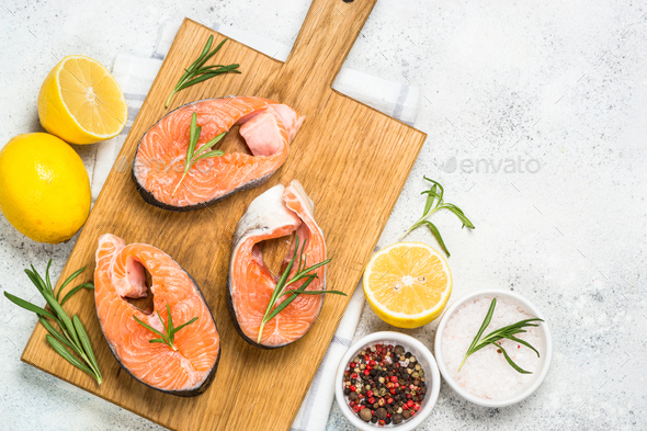 Raw salmon steak on white top view - Stock Photo - Images