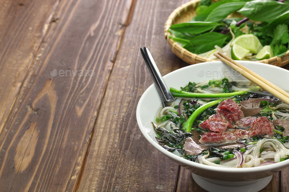 pho bo, vietnamese beef noodle soup - Stock Photo - Images