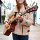 Close Up Of  Female Musician Busking Playing Acoustic Guitar  Outdoors In Street - PhotoDune Item for Sale