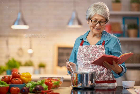 woman is preparing the vegetables - Stock Photo - Images