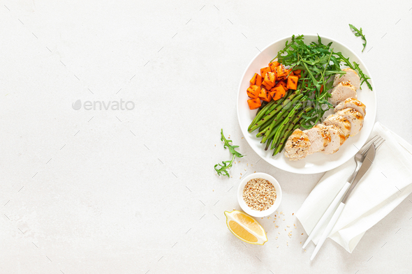 Grilled chicken breast, fillet with butternut squash or pumpkin, green beans and fresh arugula salad - Stock Photo - Images
