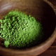 Macro photography of matcha green tea powder in a wooden bowl. - PhotoDune Item for Sale