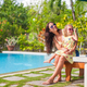 Mother and little daughter relax near swimming pool - PhotoDune Item for Sale