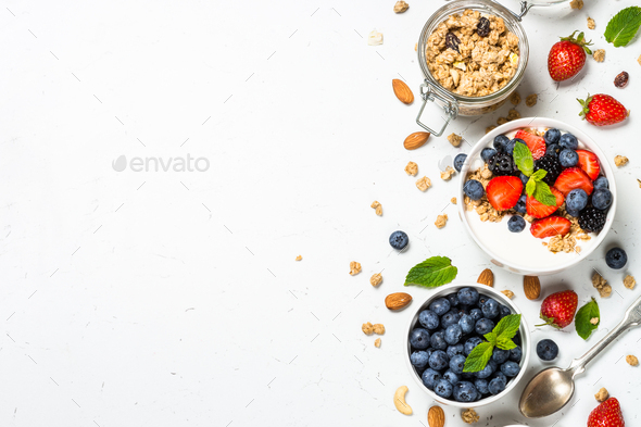 Greek yogurt granola with fresh berries on white table - Stock Photo - Images