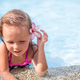 Little cute girl with flower behind her ear in the swimming pool - PhotoDune Item for Sale