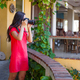 Young woman photographs the stunning view from cozy balcony - PhotoDune Item for Sale