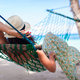 Rear view of Young woman enjoying a sunny day in the hammock - PhotoDune Item for Sale