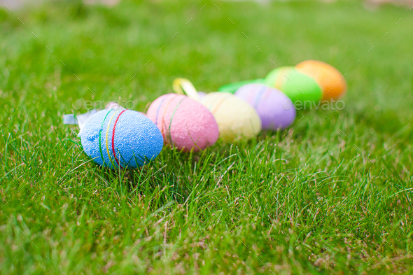 Colored easter eggs in the grass - Stock Photo - Images