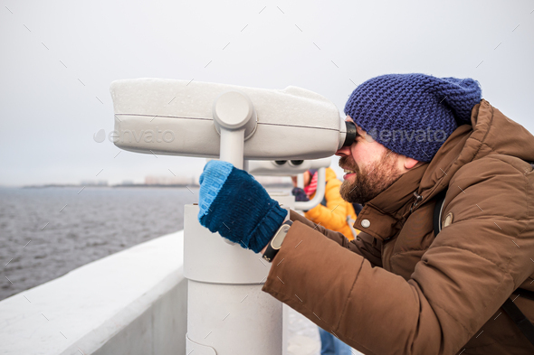 Man looks with interest in the tower viewer - Stock Photo - Images