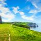 Etretat village, Church and Aval cliff. Normandy, France. - PhotoDune Item for Sale