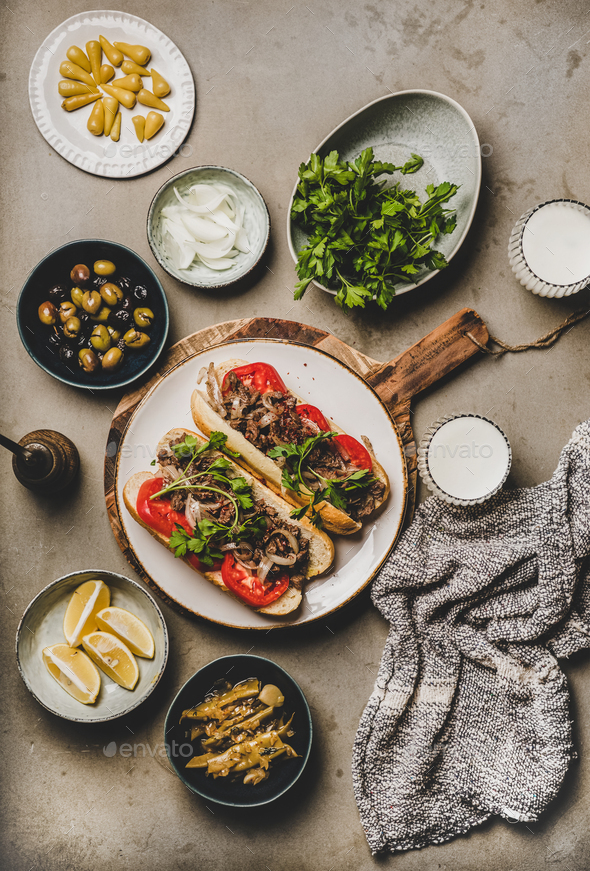 Turkish traditional meat sandwich tantuni with beef, onion and vegetables - Stock Photo - Images