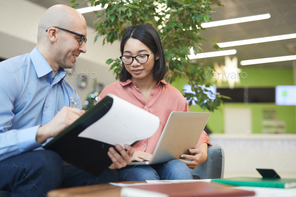 Asian Woman Talking to Internship Manager - Stock Photo - Images