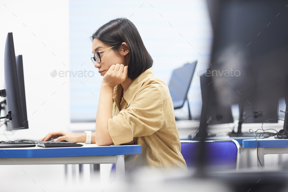 Asian Young Woman Using Computer in College - Stock Photo - Images