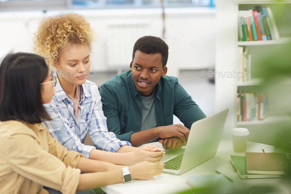 Multi-Ethnic Group of People Studying in Library - Stock Photo - Images